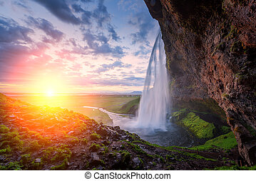Seljalandfoss - Sunrise on Seljalandfoss waterfall on...