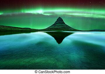 kirkjufell - Green aurora light behind kirkjufell mountain...