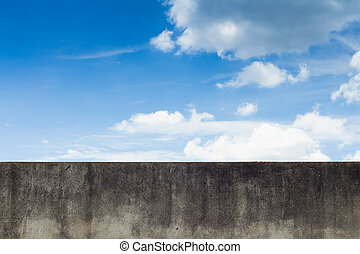 Grungy wall concrete with blue sky background