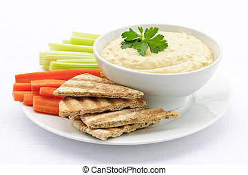 Hummus with pita bread and vegetables