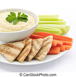Hummus with pita bread and vegetables - Healthy snack of...