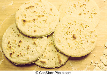 Matzah, pita bread - Cutting board with flour and ready...