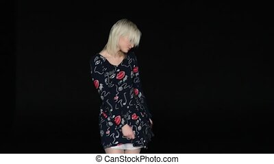 beautiful young blonde woman in nice spring dress