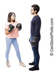Young couple fighting with boxing gloves - Full length...