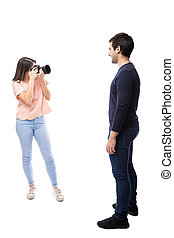 Female photographer at work - Full length view of a pretty...