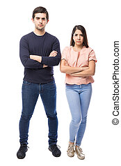 Young couple looking upset - Good looking young Latin couple...