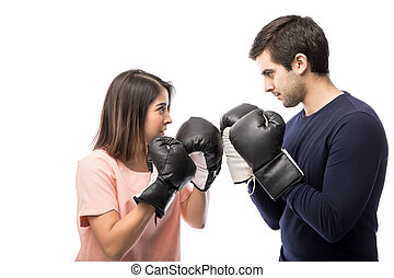 Young couple wearing boxing gloves - Profile view of a young...