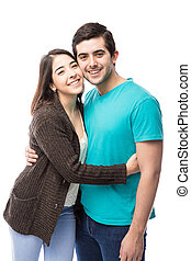 Cute young Hispanic couple dating - Portrait of a good...