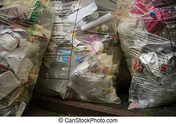 plastic waste - Yellow bags filled with plastic waste