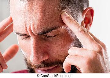 headache or esp mind power - man that seems to suffer a...