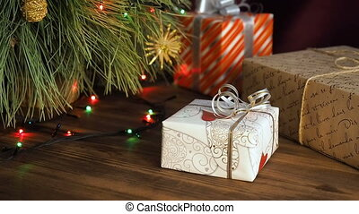 Boxes of gifts are under the tree. Gifts are Packed in...