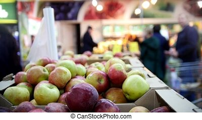 Supermarket - apples in fruit Department, close up