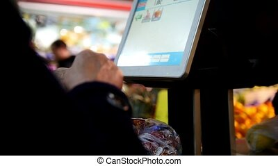 Electronic scales in the supermarket, customers - two old...