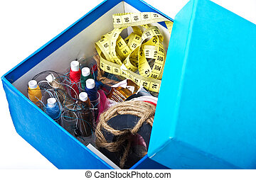 Small blue box with sewing belonging, mess