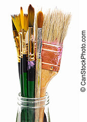 Macro view of dirty paint brushes in glass jar