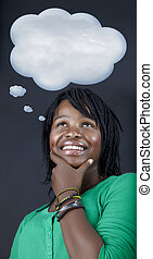 dreaming African student with a though bubble - beautiful...