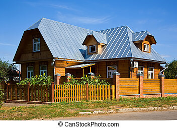 Wooden country house in summer sunny day