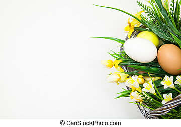 Easter holiday background, a basket with spring flowers and...