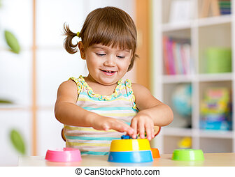 kid little girl playing with toys at home - kid little girl...