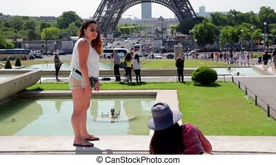 FRANCE, PARIS: Girl posing near famous Eiffel Tower -...