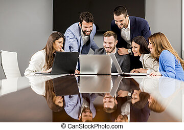 Young successful managers discussing new business project in...