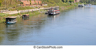 boats and the ticino river from the wooden bridge - boats...