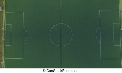 Aerial above empty soccer field - Aerial shot above empty...