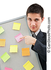 Businessman showing onto the reminder board