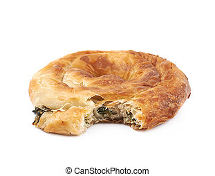 Cheese and spinach pastry bun with a bite taken off it,...