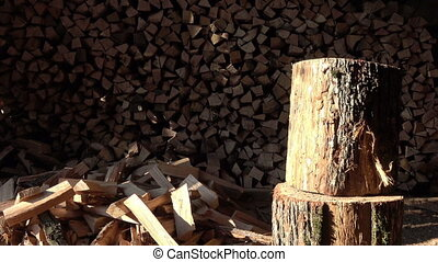 A man split oak log long old ax on a background of stacked...