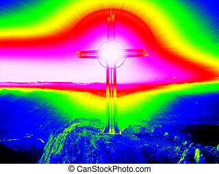 Infrared photo. Steel crucifix at mountain peak in Alps. -...