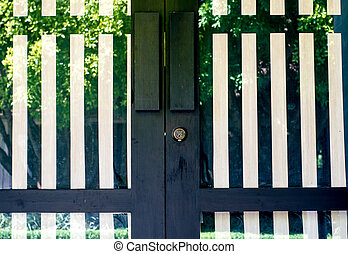 Black door - Door, black and white stripes made of metal and...