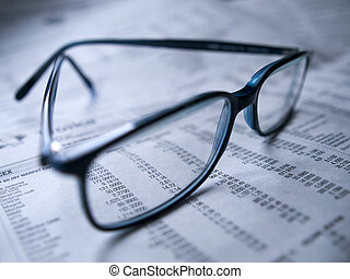 Financial figures - Symbolic picture of glasses over a...