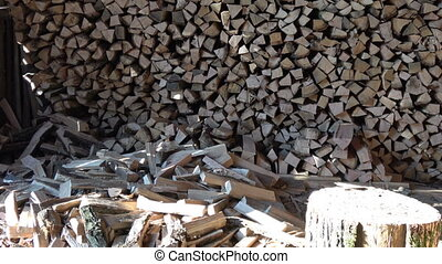 Dumping wood on the pile. Logging of firewood on a woodpile...