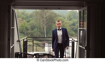 Young Man Coming into Hotel Room - Young attractive groom...
