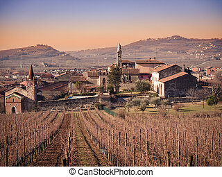 View of Soave (Italy) surrounded by vineyards. - View of...