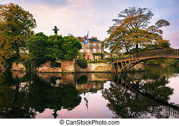 Walton Hall in a scenic setting of rolling parkland with its...