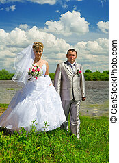 Wedding pair on coast of the river