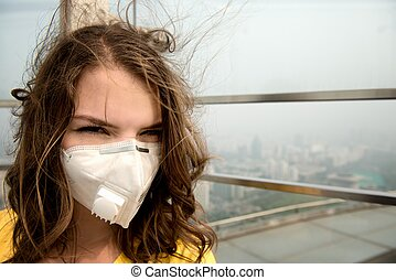 Woman in medical mask against the air pollution close-up