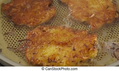Close up of potato fritters - Potato fritters in a steel pan