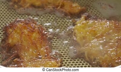 Potato fritters in a steel pan