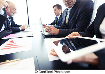 Business people analyzing financial - Business people at...