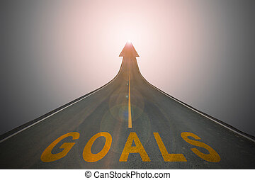 The goals words on the surface of the street with arrow...