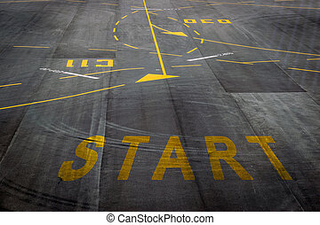 The start words on the surface of the airport runway...