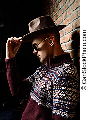 headwear style - Portrait of a handsome man wearing sweater...