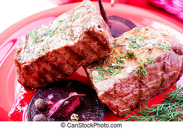 Beef steaks with beetroot