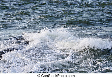 the water spash to the rock and begins to be foam