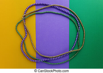Mardi Gras beads background with place for text. Top view