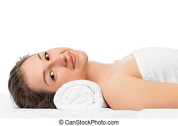 smiling girl on a massage table in the office cosmetologist