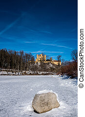 View to Hohenschwangau from the Alpine Lake in Germany